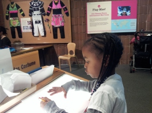 Snaggle concentrating on a costume at the Brooklyn Museum.